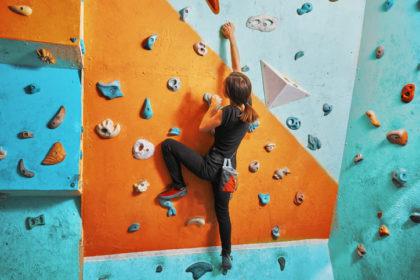 woman learning to rock climb