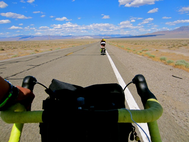 bike handlebars with the open road